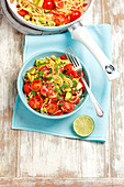 Spaghetti with cherry tomatoes and avocado