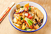 Stir fried chicken with cashew nuts, red peppers, onions, spring onions, pinapple, chilli, carrots in a sweet oyster sauce