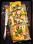 A savory puff pastry tart with caramelised onions and goat's cheese
