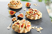 Fig and hazelnut tartlets with vanilla cream and date-caramel (vegan)