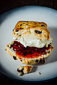 A scone with jam and clotted cream (England)
