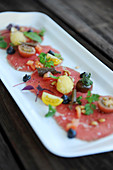 Tomato carpaccio on a platter