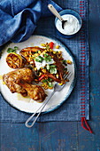 Roast chicken with a stuffed sweet potato