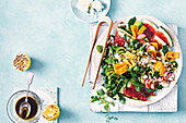 A salad with grilled watermelon and pomegranate dressing