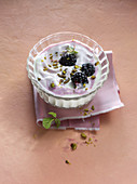 Yogurt with blackberries and pistachios