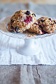 Scones with blueberries and raspberries on a cake stand