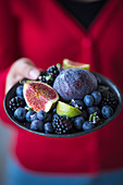 A plate of blackberries, blueberries and figs