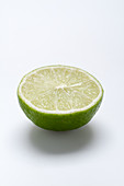 Half a lime on a white surface