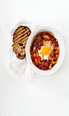 Baked eggs with tomato and sweet peppers