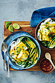 Spicy coconut fish curry with rice noodles