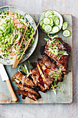 Asian slow cooked teriyaki beef with sesame udon noodle salad
