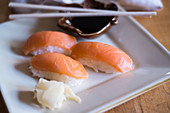 Nigiri sushi with salmon, ginger and soy sauce