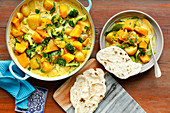 Vegetarian curry with potaoes, pumpkin and broccoli