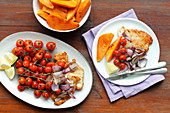 Turkey schnitzel, sweet potatoes and baked tomatoes