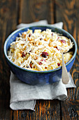 Celeriac and pineapple salad with cranberries and yogurt