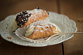 Cannoli (deep-fried pastry rolls filled with cream, Sicily)