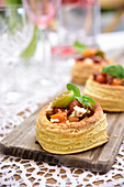 Puff pastry tarts with tomatoes and feta