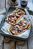 Tarte flambé with red cabbage and apples