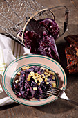 Red cabbage salad with bacon and Emmental cheese