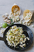 Popcorn with chilli, ginger, garlic and lime