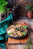 Chicken in a creamy sauce with mushrooms and herbs