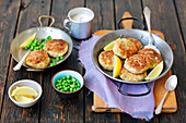 Tuna and potato cakes with green peas