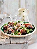 A salad with parma ham, figs and rocket