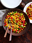 Sweet corn with spring onions and roasted red pepper