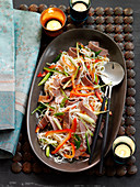 Warm rice noodle salad with beef