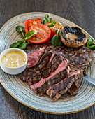 T-Bone-Steak with tomatoes, grilled mushrooms and bernaise sauce