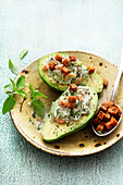 Avocado halves topped with crab and wasabi yogurt