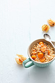 Bulgur and almond muesli with physalis