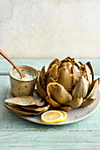 Steamed artichoke with a green soy and sorrel dip