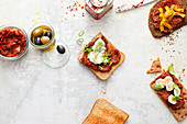 Spicy sandwiches with a trio of olive and tomato spreads