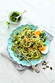 Buckwheat and courgette spaghetti with parsley pesto
