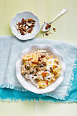 Bircher muesli with apples, cottage cheese and thick juice