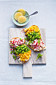 Healthy colourful vegetable cubes on bread, and Harzer cheese