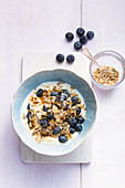 Rustic flake muesli with blueberry yoghurt