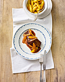 A duck breast fillet in red wine and orange sauce