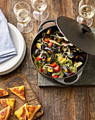 Mussels in fennel and vegetable broth with cheesy toast
