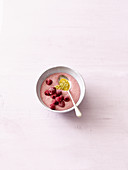 Amaranth porridge with raspberries and passion fruit