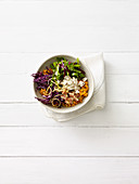 Colourful millet salad with figs, red cabbage and feta cheese