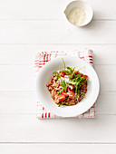 Millet risotto with tomatoes and rocket