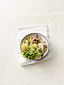 Brussels sprouts bowl with bulgur, beans, beansprouts and yoghurt