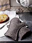 Oven-gloves hand-made from thick grey felt