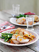 Roasted pork loin with fried potatoes and green beans
