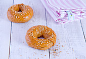 Sesame seed bagels on a wooden surface