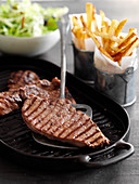 Minute steaks with french fries and salad