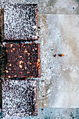 Chocolate cake with ground peanuts and powdered sugar