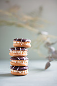 Sandwich cookies with chocolate icing